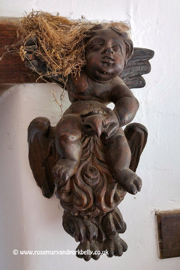 Carved wooden angel - The Manor Hemingford Grey, Cambridgeshire