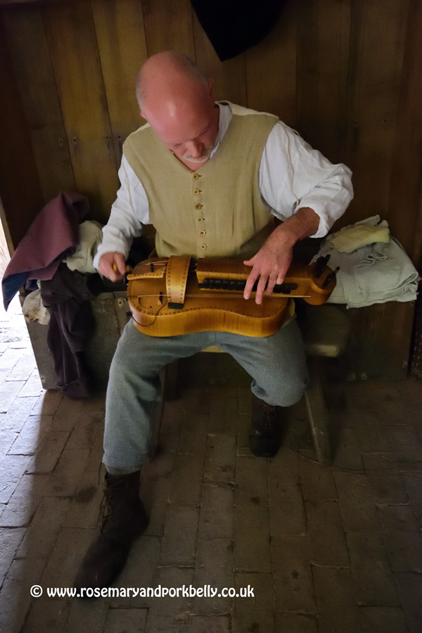 Playing the hurdy-gurdy - Weald and Downland Museum West Sussex
